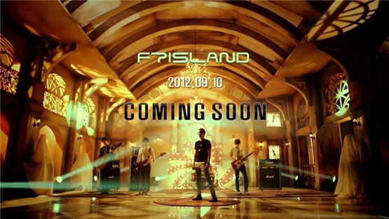 FTisland members pose with their instruments in a group photograph for their teaser video, set to become available online on Septmber 6, 2012. [FNC Entertainment]