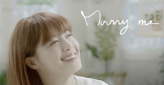 "Ku Hye-sun smiles brightly in the music videoof her new song ""Marry Me,"" released on October 15, 2012. [YG Entertainment]"