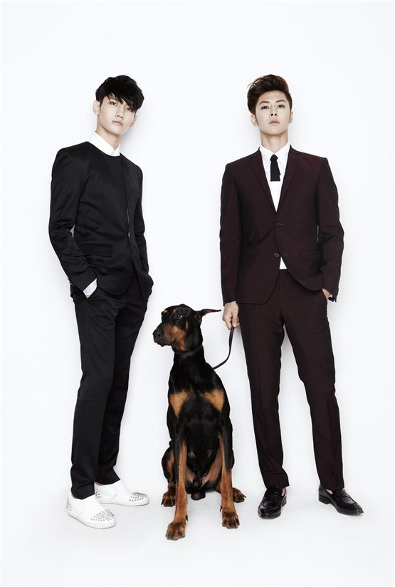 "TVXQ! members Max Changmin (left) and U-Know Yunho (right) pose in simple black and wine-colored suits in a photo released for the duo's sixth album ""Catch Me,"" dropped on September 24, 2012. [SM Entertainment]"