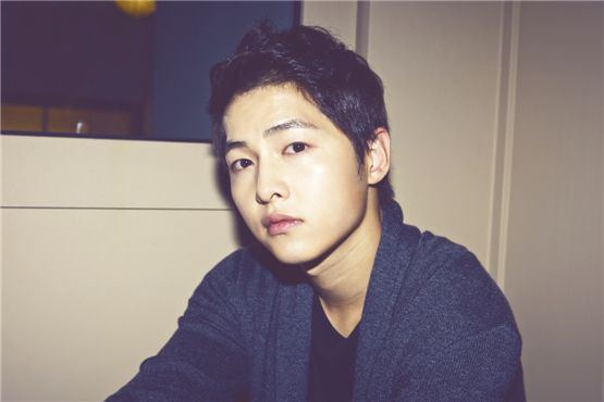 Korean actor Song Joong-ki poses in front of the camera in a photo taken during an interview with 10Asia. [Chae Ki-won/10Asia]