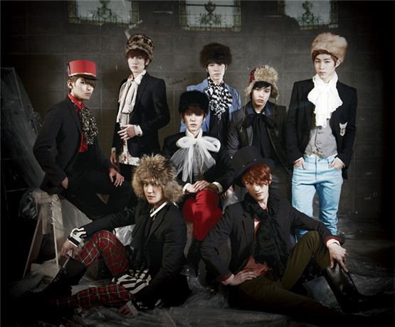 """Super Junior-M members Ryeowook (top left), Eunhyuk (top second to left), Kyuhyun (top third to left), Donghae (top third to right), Sungmin (top second to right), Henry (top right), Siwon (bottom left) and  Zhou Mi (bottom right) pose together for their second mini-album """"Perfection,"""" dropped on February 28, 2011. [SM Entertainment]"""