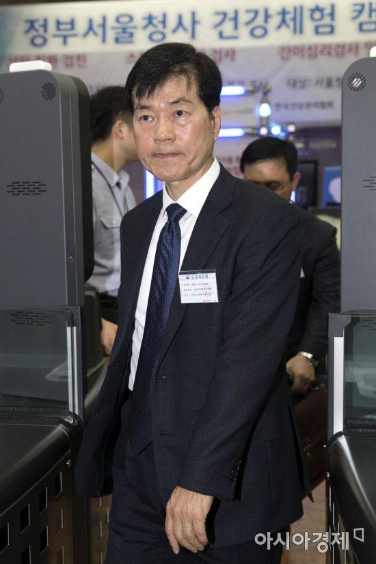 [포토] 정부청사 들어서는 김태한 사장