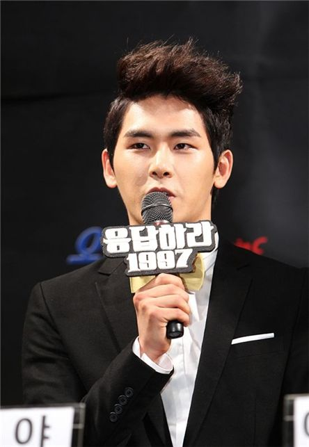 "INFINITE's Hoya answering reporters' questions at the tvN's ""Reply 1997"" press conference held in Seoul, South Korea on July 12, 2012. [tvN]"