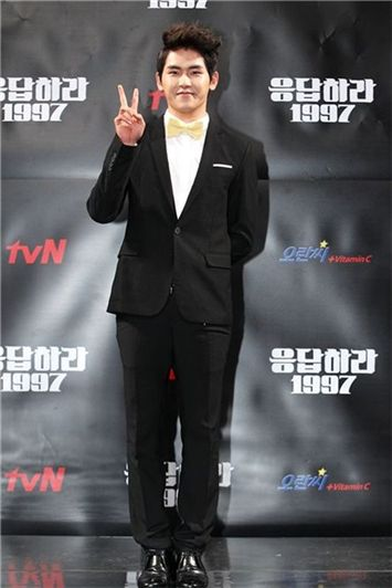 "INFINITE's Hoya posing infront of a photo wall at the tvN's ""Reply 1997"" press conference held in Seoul, South Korea on July 12, 2012. [tvN]"