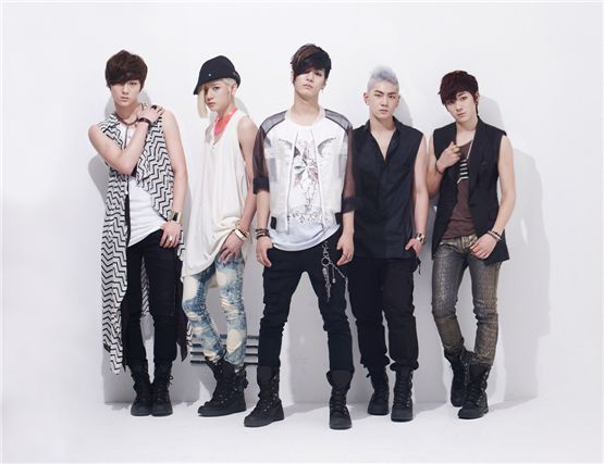 """Minhyun (left), Ren (second to left), JR (center), Baekho (second to right) and Aron (right) pose in the cover photo of """"Action"""" released on July 11, 2012. [Pledis Entertainment]"""