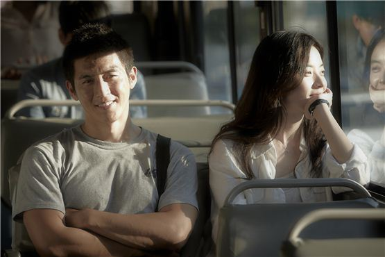 """Ko Soo (left) and Han Hyo-joo (right) sit in a bus together for their final shooting for their upcoming pic """"Love 911"""" at Gangnamdaero in southeastern part of Seoul, Korea on September 6, 2012. [NEW]"""