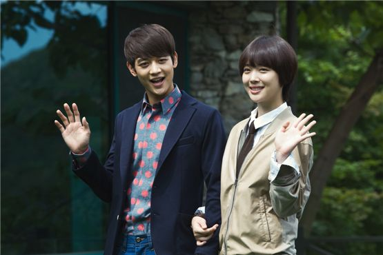 """SHINee's Minho (left) and f(x) member Sulli pose in front of the camera at a press conference for SBS' Wednesday and Thursday TV series """"For You in Full Blossoms,"""" held in Gyeonggi Province, South Korea, on August 27, 2012. [Lee Jin-hyuk/10Asia]"""