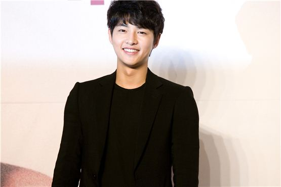 """Korean actor Song Joong-ki smiles at a press conference for KBS """"The Innocent Man"""" held in Seoul, South Korea on September 5, 2012. [Lee Jin-hyuk/10Asia]"""
