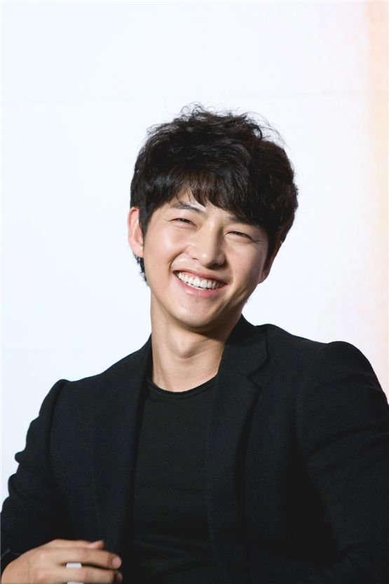 "Korean actor Song Joong-ki smiles during the press conference of KBS ""The Innocent Man"" held in Seoul, South Korea on September 5, 2012. [Lee Jin-hyuk/10Asia]"