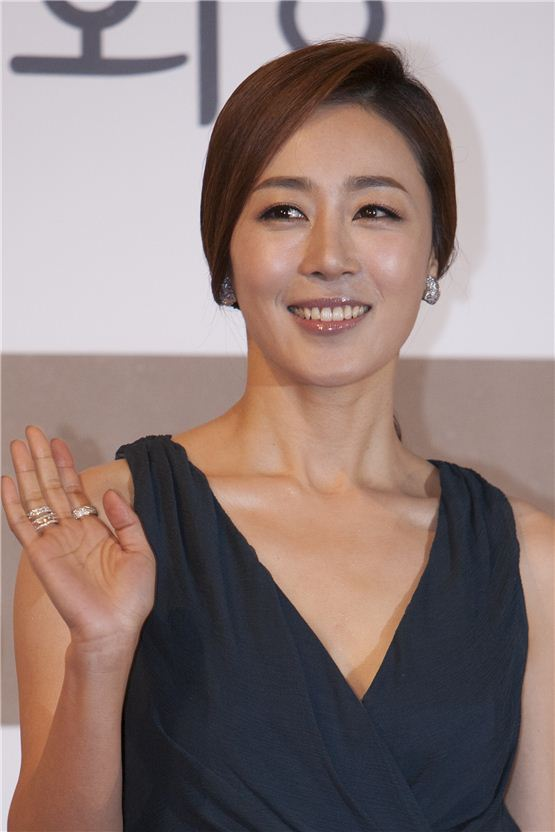 Actress Moon Jeong-hee poses in front of the photo wall at the 33th Blue Dragon Film Awards ceremony held at the Sejong Center in Seoul, South Korea on November 30, 2012. [10Asia/ Brandon Chae]
