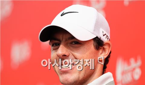 """매킬로이>우즈 """"절반의 성공"""""""