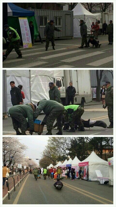 ▲벚꽃축제가 열리고 있는 서울 여의도 여의서로에서 군복을 입은 사람들이 장애인 행상을 단속하고 있다.(출처:트위터)