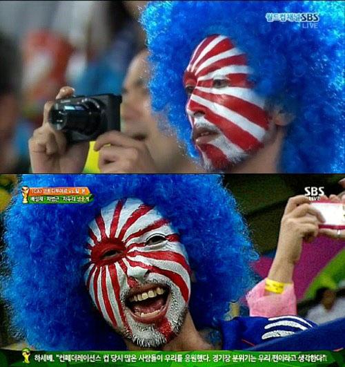 ▲일본 그리스전 경기에 일본팬들이 전범기를 그리고 나와 논란이 일고있다.(사진:SBS 중계화면 캡처)