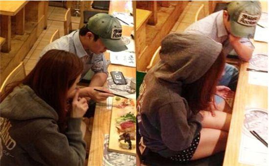 초밥집에서 함께 식사를 하고 있는 홍진호와 레이디 제인[사진=온라인 커뮤니티]