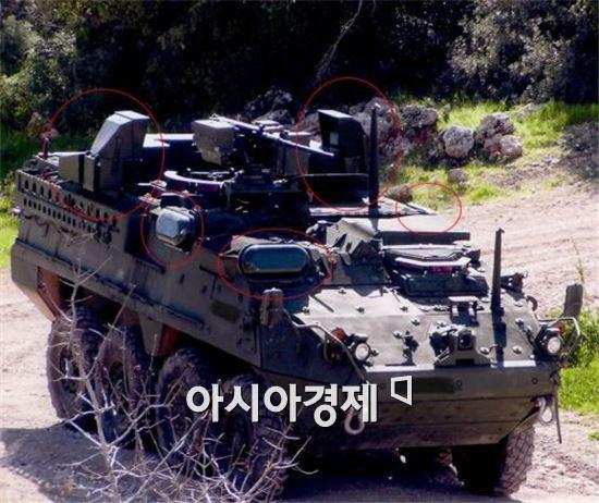 이스라엘 라파엘의 트로피 APS(붉은색 원 부분)를 탑재하고 시험중인 스트라이커 장갑차
