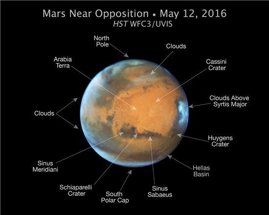 ▲화성의 북극과 남극, 구름 등 생생한 모습이 보인다.[사진제공=NASA]
