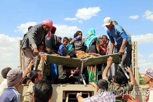 지난 6월 IS 점령지에서 탈출한 이라크 난민. 사진= EPA 연합뉴스 제공