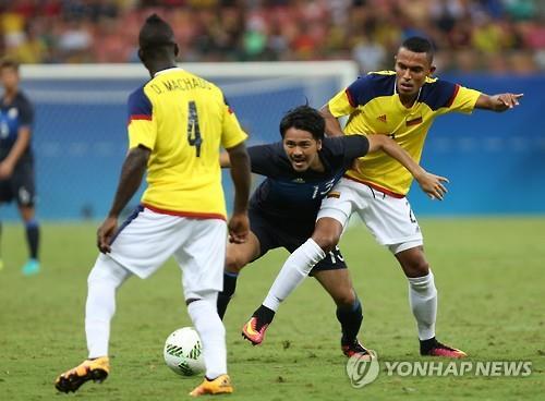 일본과 콜롬비아의 축구 한 장면. / 사진제공=연합뉴스