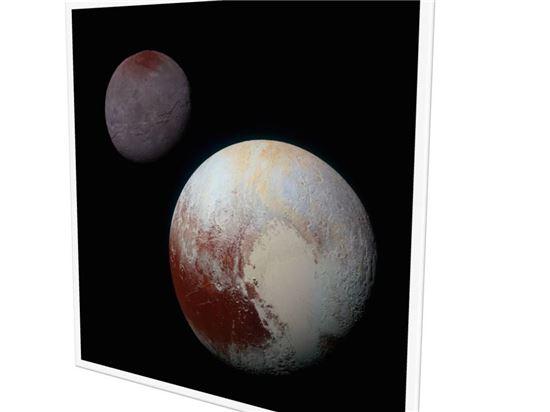 ▲명왕성의 스푸트니크 평원은 위성인 카론과 정반대에 위치해 있다. 이 때문에 스푸트니크 평원 아래 추가질량을 가진 바다가 있을 것으로 니모 교수는 추론했다.[사진제공=NASA]