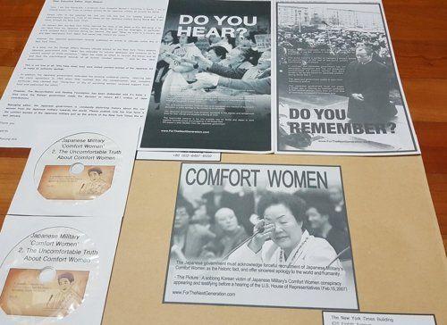 서경덕 성신여대 교수 측이 '뉴욕타임스' 편집장에게 보낸 서한과 일본군 위안부 관련 영상 CD. 사진=서경덕 교수 제공·연합뉴스