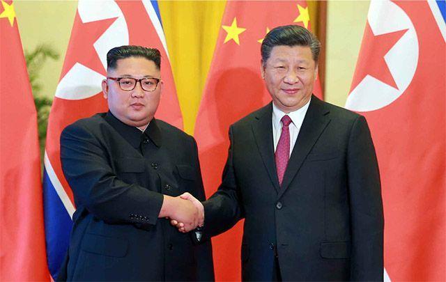 시진핑 중국 국가주석과 김정은 북한 국무위원장(왼쪽)