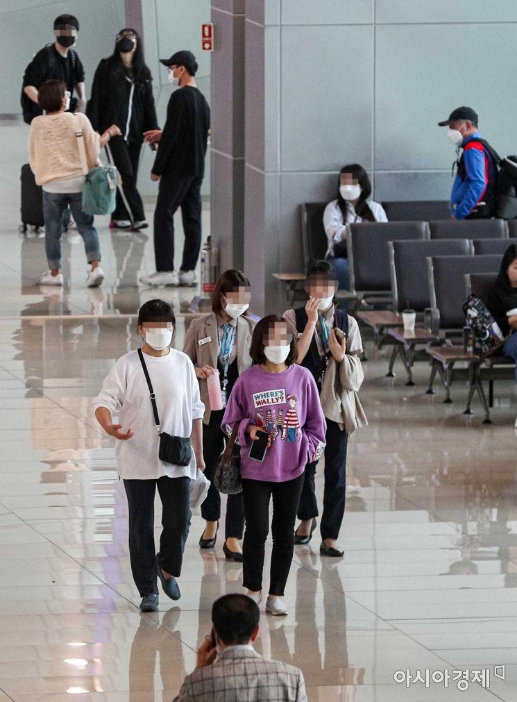 [포토]마스크 착용한 공항 이용객들