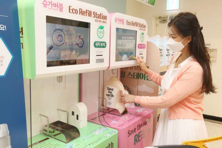 이마트·트레이더스, '세제 리필 자판기' 8개 점포로 확대